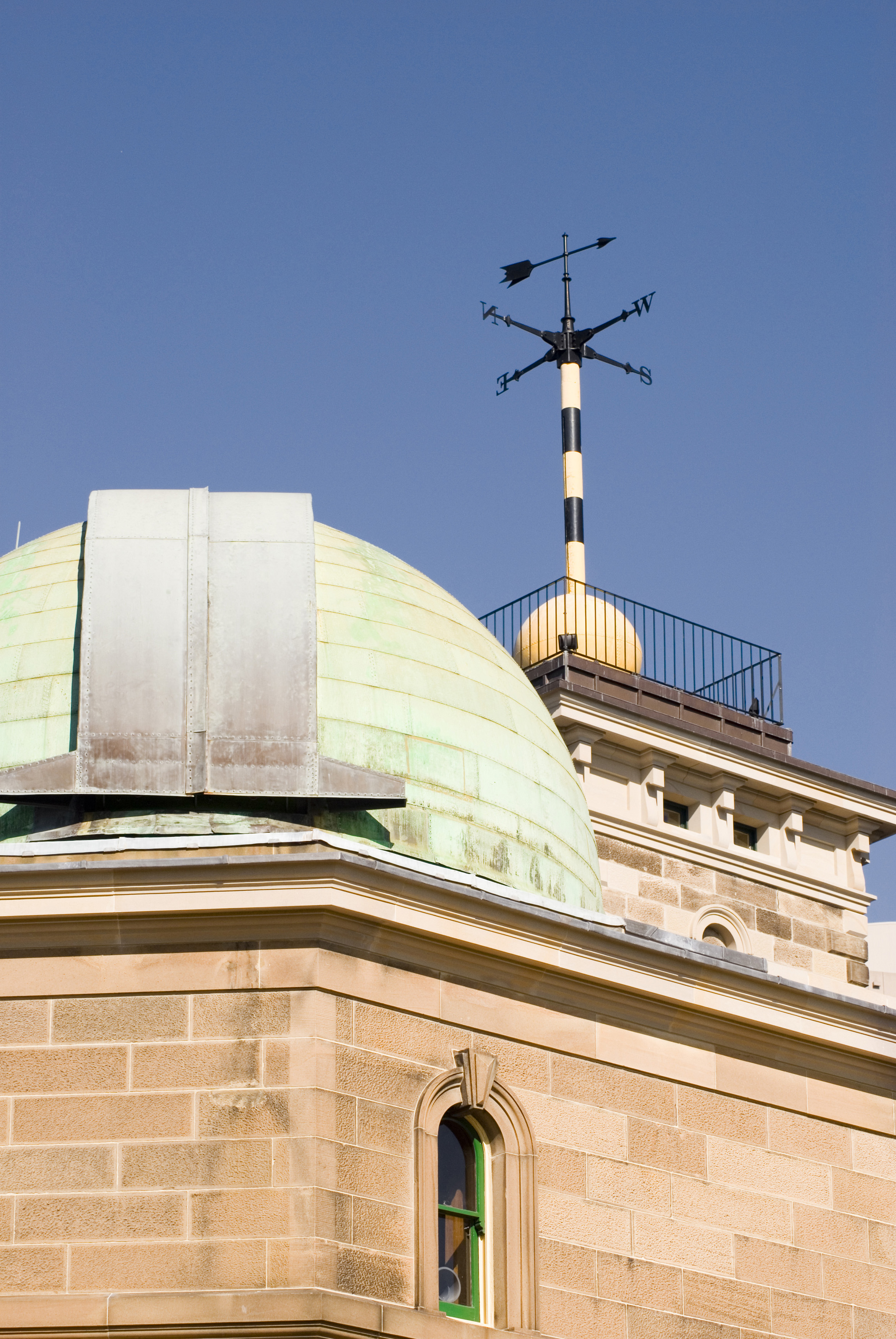 the roof of an observatory with telescope dome an time signal ball