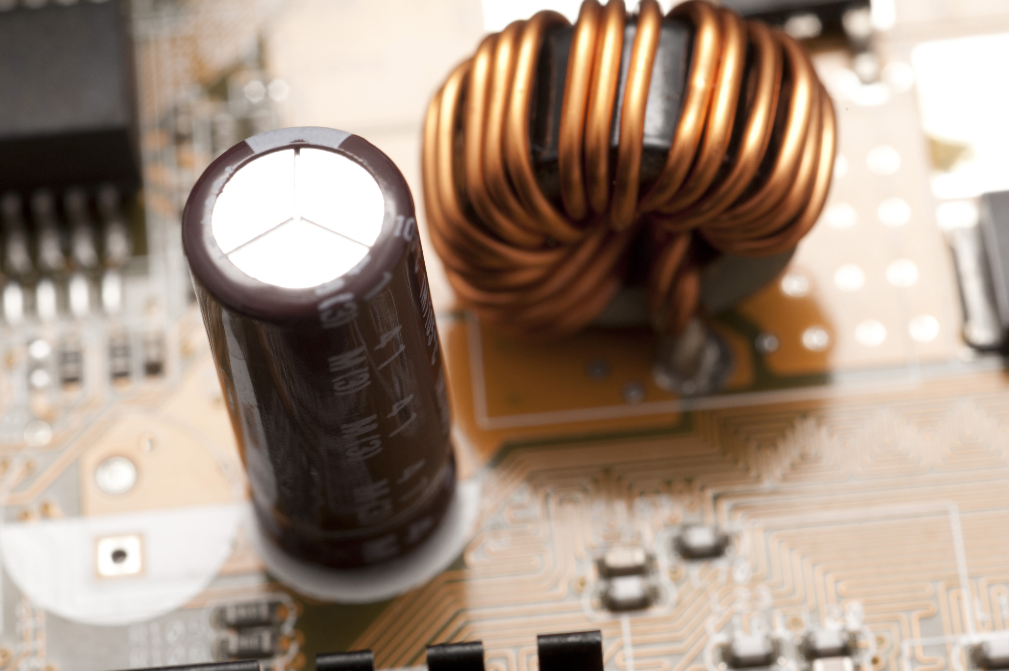 an emi choke inductor and filter capacitor in a switch mode power supply, used to filter high frequency from interefering with other electronics near by or connected to the supply