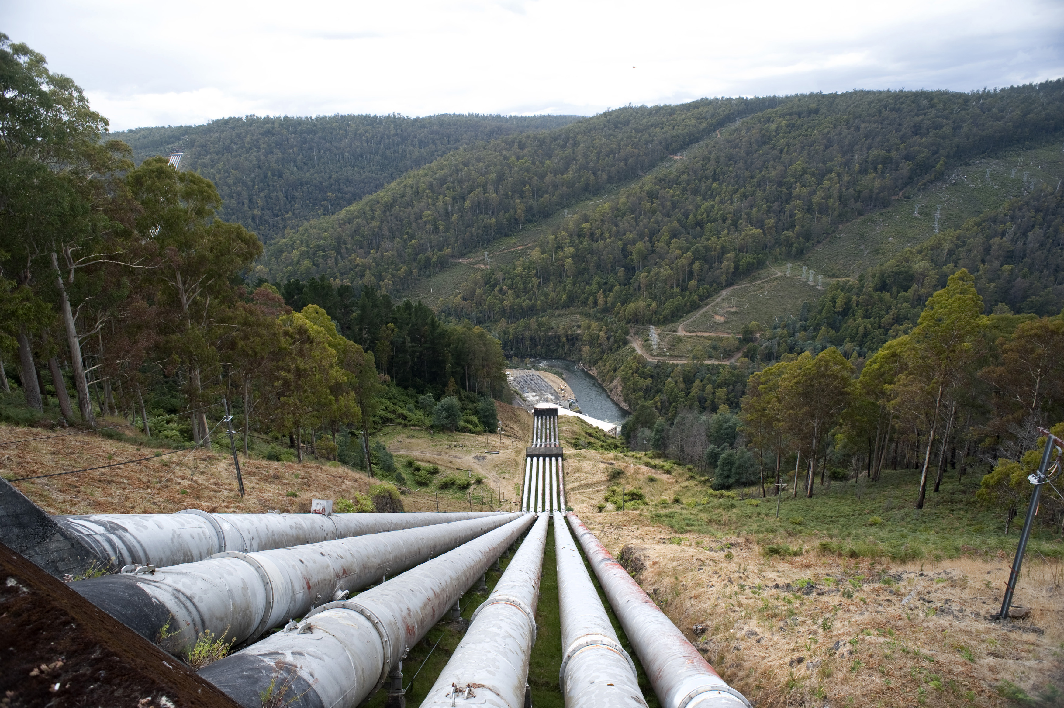 Water pipes at a hydroelectric scheme transporting water to the turbines to generate electricity, renewable or alternative energy concept