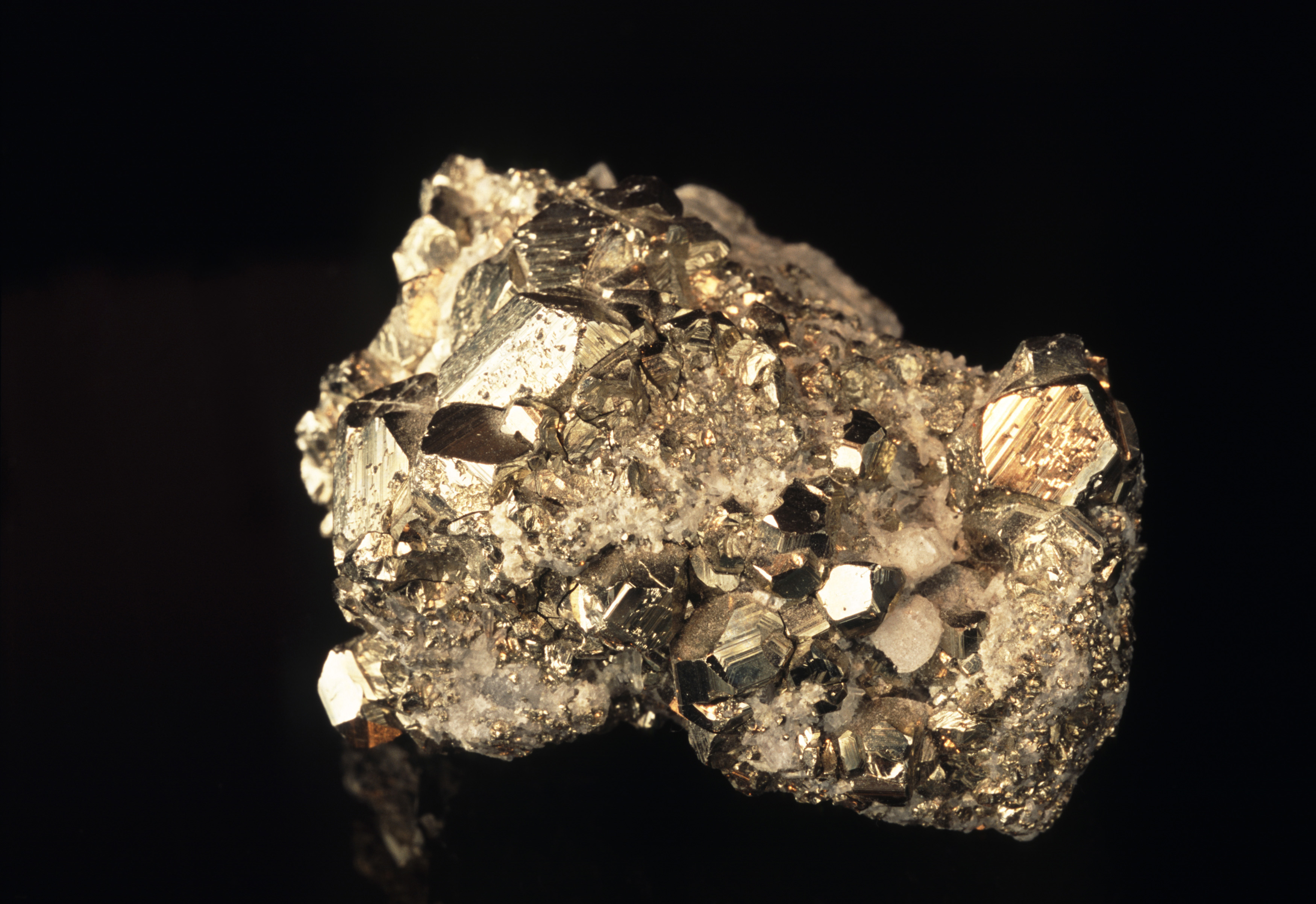 Specimen of crystals of fools gold or iron pyrites on matrix with its characteristic metallic gold appearance