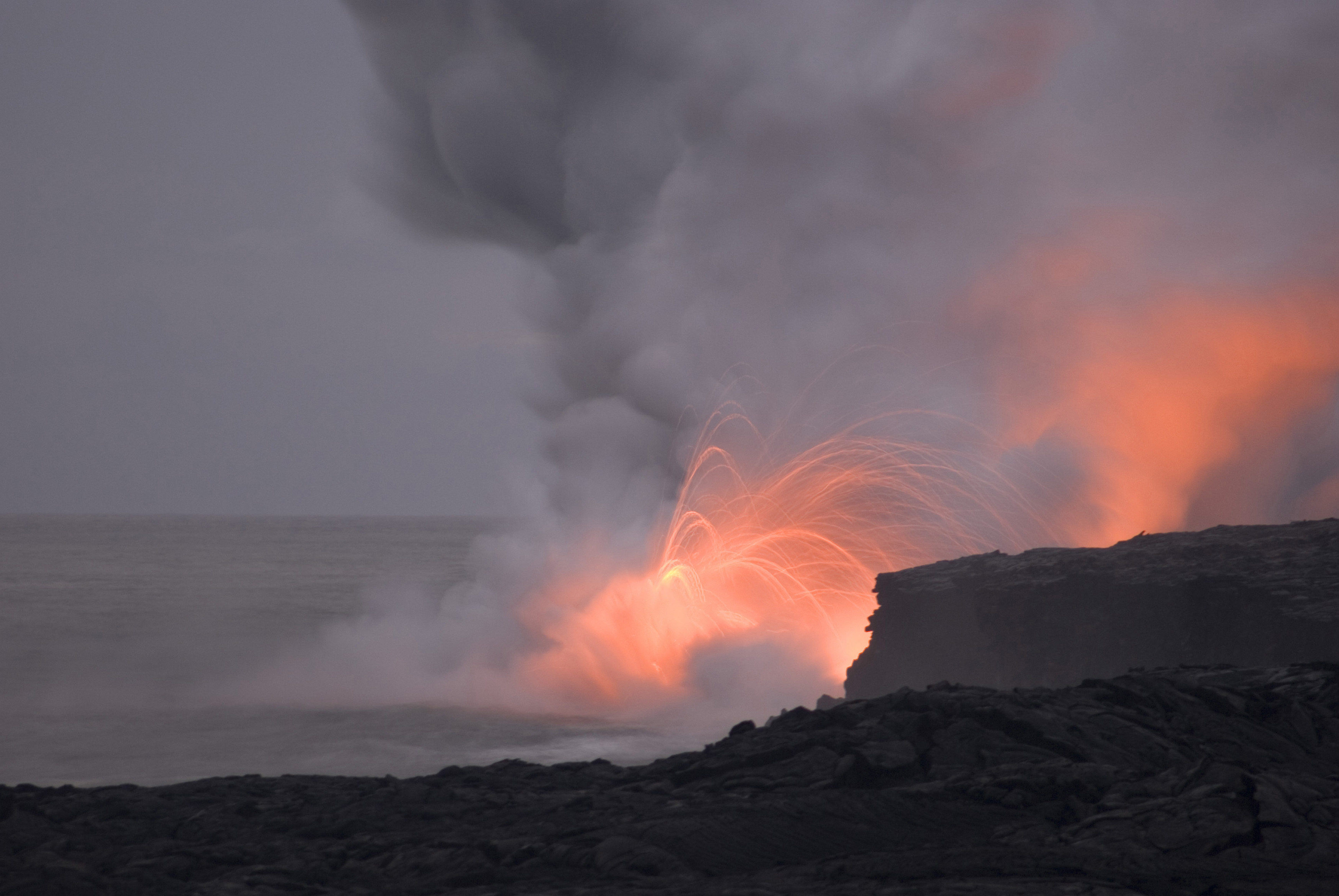 red hot lava shooting through the air into the sea makes a spectacle for travellers visiting hawaiiis big island, Hawaii, USA