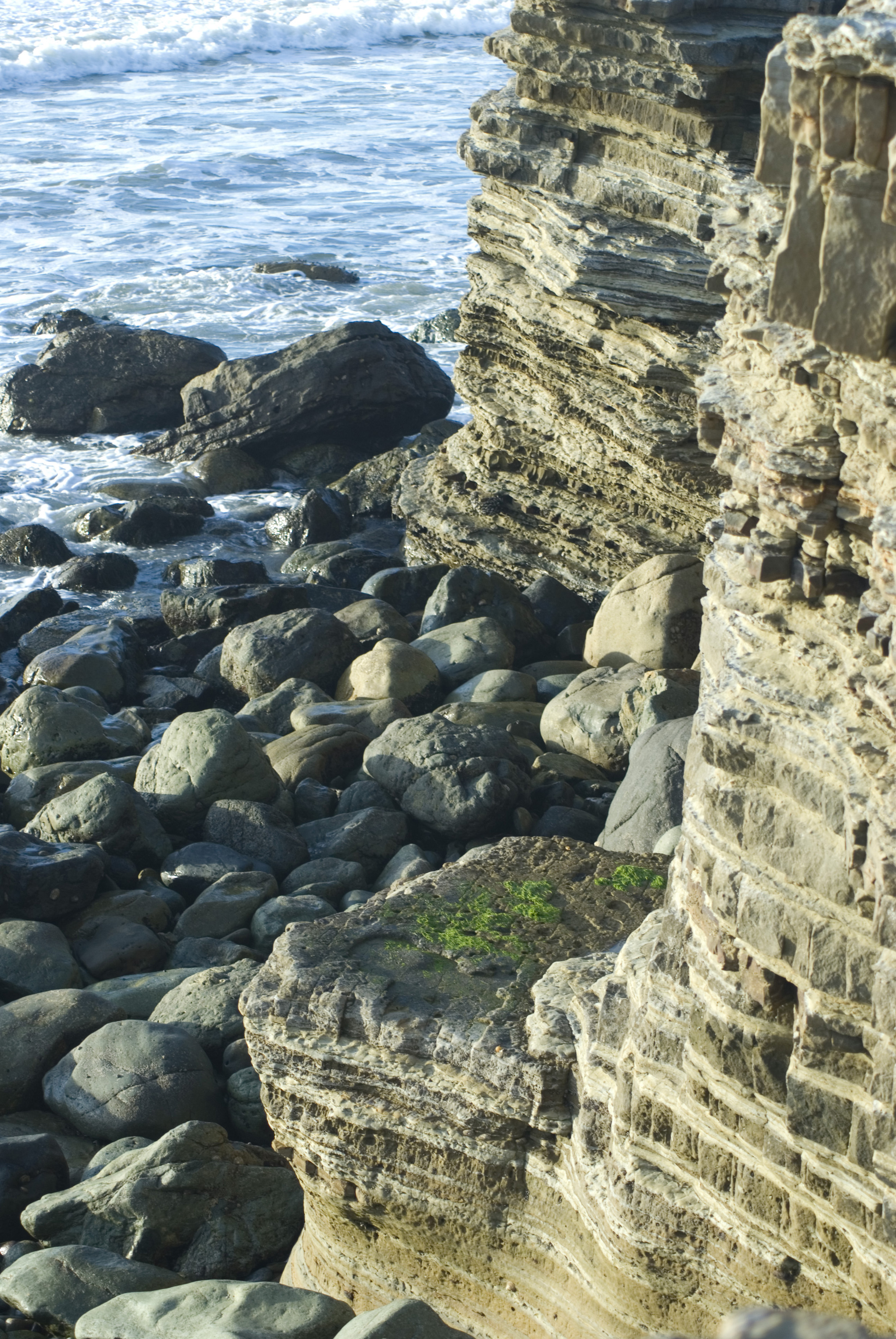 layered sedimentary cliffside rocks at cabrillo national monument, san diego california