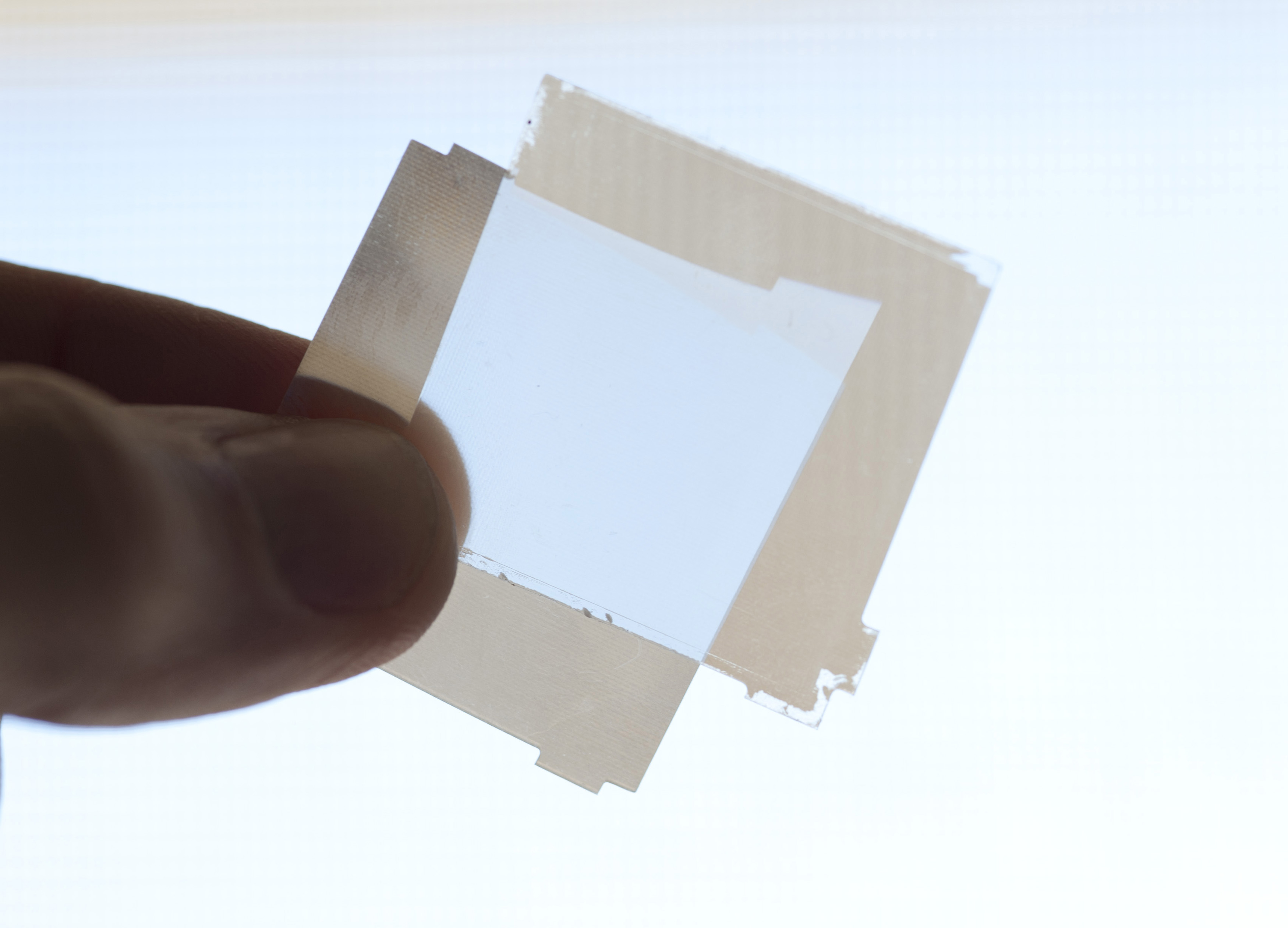 sheets of polarizing material block and admit light from different angles when overlapped