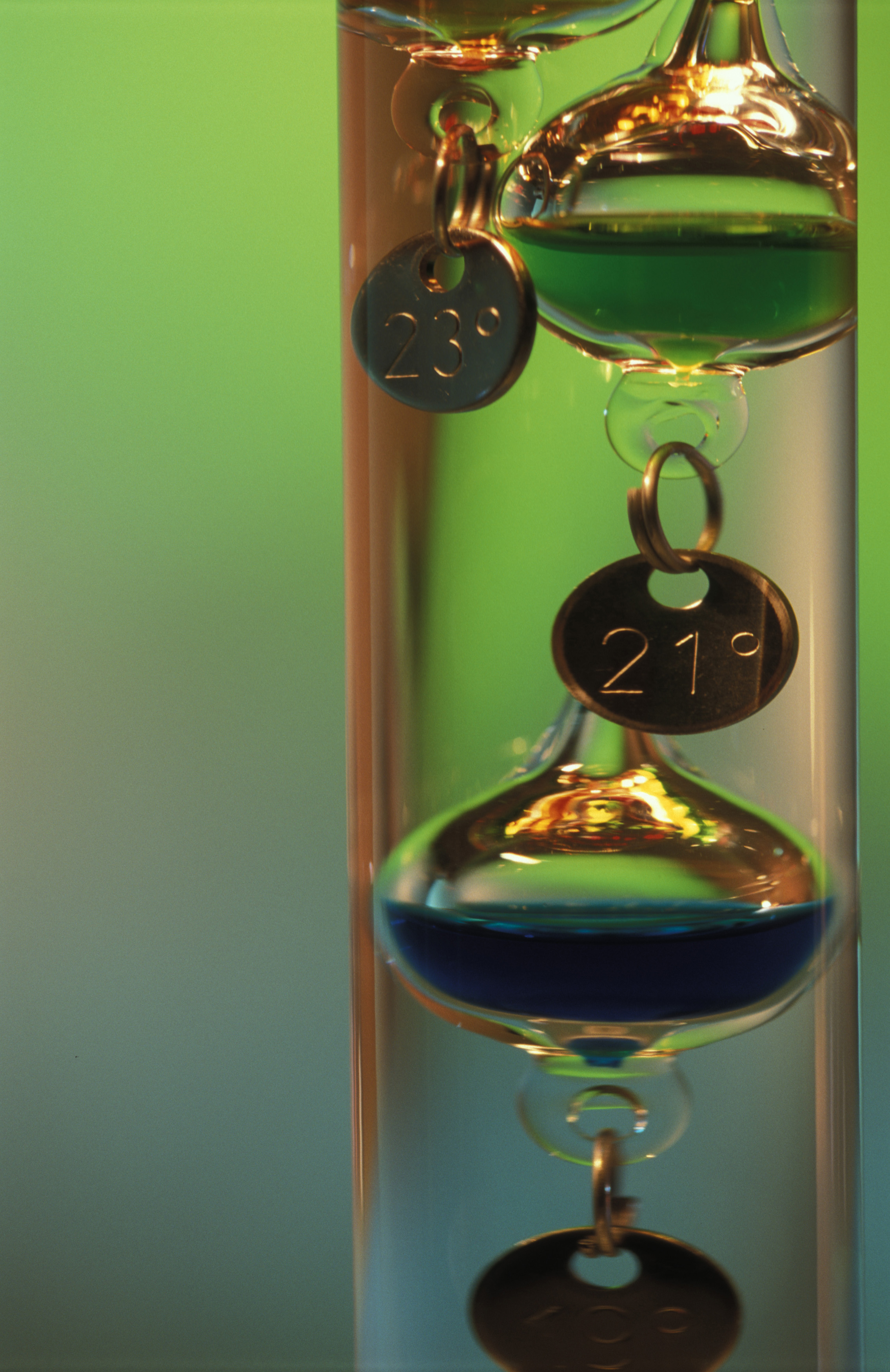 Floats in a Galileo thermometer, made of a sealed glass cylinder containing a clear liquid and several glass vessels of varying densities that rise and fall with temperature changes.