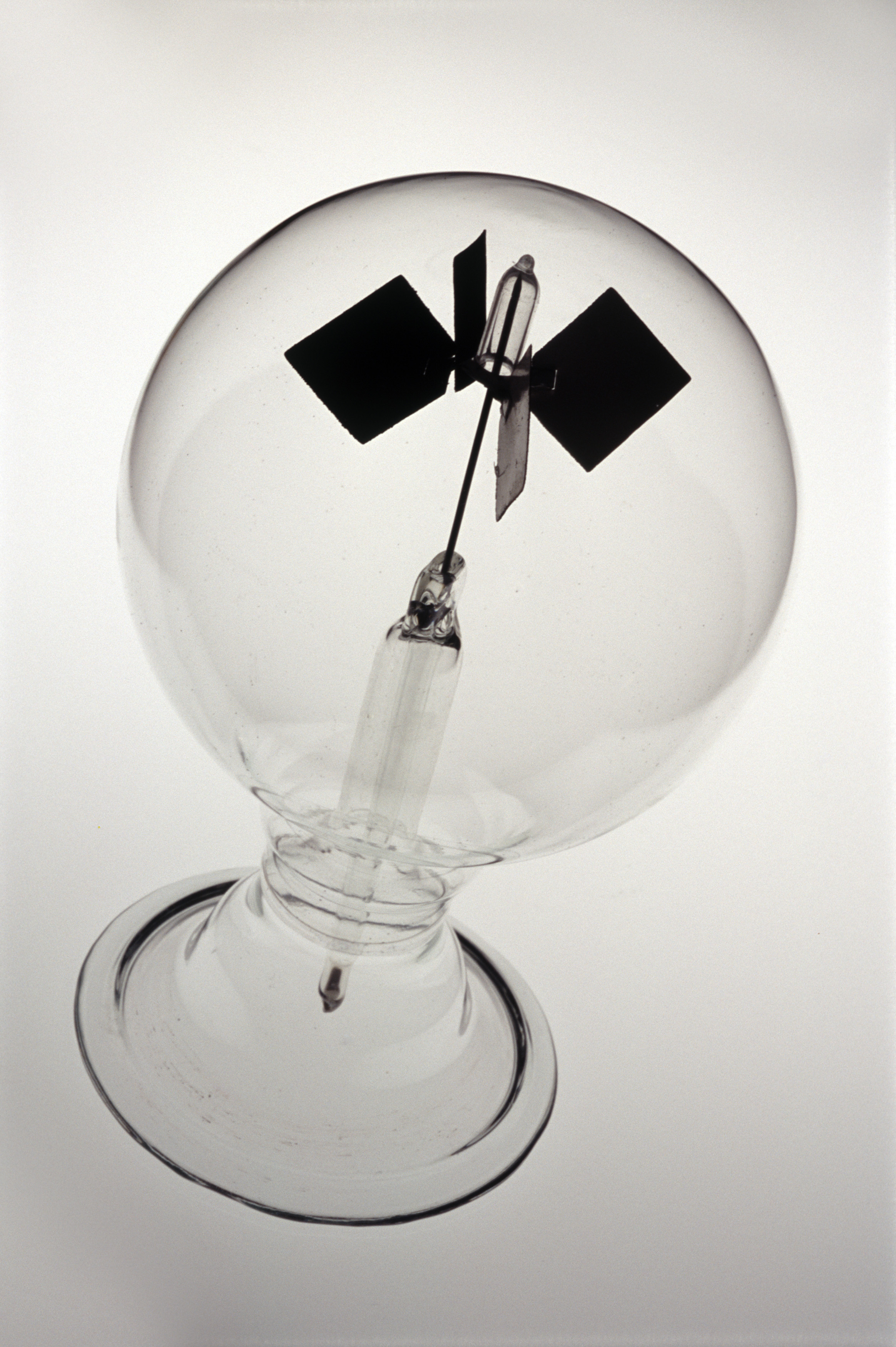 Crookes radiometer or light mill is an airtight globe with a partial vacuum, light falling on the blades of the willdmill in the centre causes them to rotate